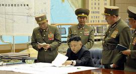 Kim Jong Un with military commanders