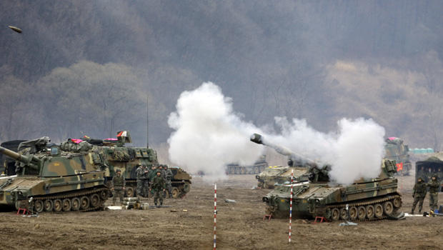 South Korean marine's K-55 self-propelled howitzer fires during a military exercise in the border city between two Koreas, Paju, north of Seoul, South Korea, Tuesday, April 2, 2013.