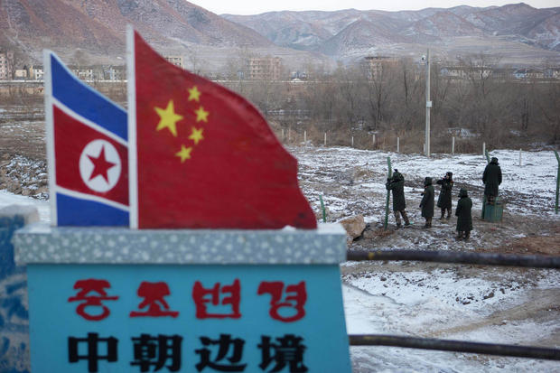 Chinese paramilitary police build a fence along the country's border withy North Korea.