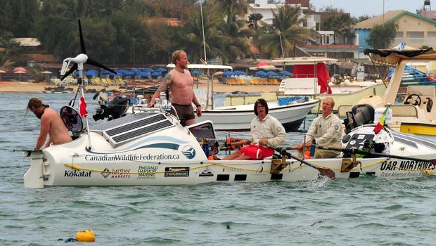 American Jordan Hanssen, Canadian Adam Kreek, American Pat Fleming and Canadian Markus Pukonen leave on January 23, 2012 Ngore beach outside Dakar in an attempt to row across the Atlantic to reach Miami, Florida, aboard an 8.8 meter long boat.