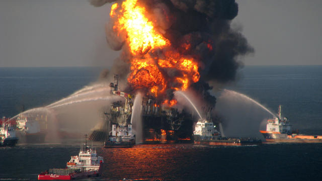 In this handout image provided be the U.S. Coast Guard, fire boat response crews battle the blazing remnants of the off shore oil rig Deepwater Horizon in the Gulf of Mexico on April 21, 2010 near New Orleans, Louisiana.