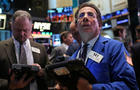 Traders work on the floor of the New York Stock Exchange on Apr. 15, 2013, in New York.