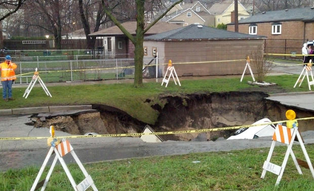 A sinkhole swallowed three cars on the Southeast Side of Chicago on, April 18, 2013 injuring one person.