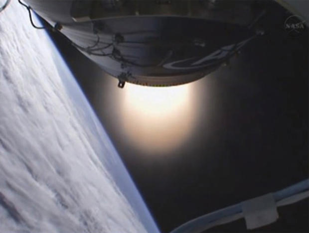 The Antares second-stage solid-fuel motor fires to push a dummy payload into orbit.