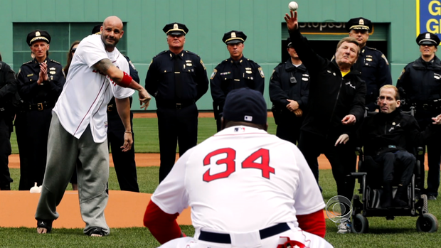Steve Byrnes throws the opening pitch at Fenway Park.