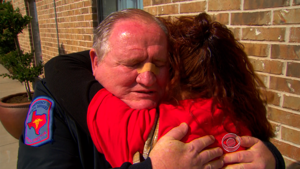 Dr. George Smith hugs a fellow Texan grieving over the loss of 14 first responders in West.