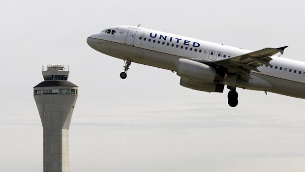 A United Airlines jet departs in view of the air traffic control tower at Seattle-Tacoma International Airport Tuesday, April 23, 2013, in Seattle.