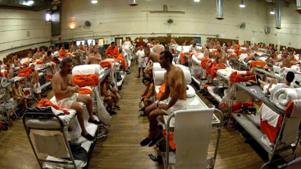 This picture, taken in 2006, shows prisoners being held in tight quarters in a gymnasium. The California Department of Corrections says they no longer house prisoners at this location.;