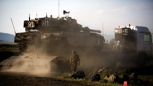 An Israeli Merkava tank is positioned for deployment during a drill in the Israeli annexed Golan Heights near the border with Syria on May 5, 2013. Israel carried out a pre-dawn air strike near Damascus, targeting Iranian missiles destined for Lebanon's H