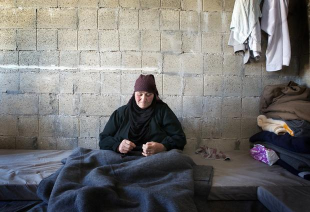 Hamdah, 70, trapped in her hut at the Zaatari camp
