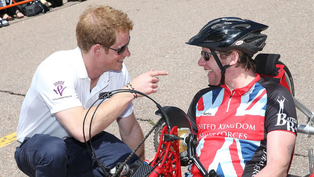Prince Harry speaks to competitors as he attends the US airforce training academy hand cycling event at the Warrior Games during the fourth day of his visit to the United States on May 12, 2013 in Colorado Springs, Colorado.