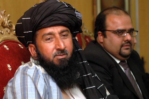 Pakistani tribesman Karim Khan (left), and his lawyer Mirza Shahzad Akbar