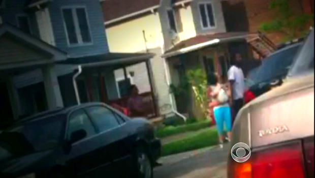 Cell phone video captures Amanda Berry and her child in their first moments of freedom outside Ariel Castro's home.