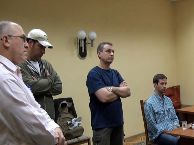 Ryan Fogle and three U.S. Embassy officials are seen at an FSB office in Moscow