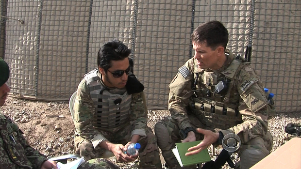 U.S. soldiers in Afghanistan discuss a plan to bring Afghan soldiers with them on a search for roadside bombs.