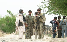 One year after Afghan massacre, villagers work with U.S. troops