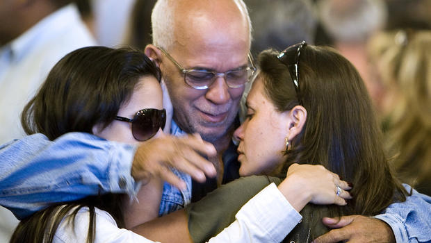 Friends and relatives of Air France Flight 447 passengers comfort each other after attending a Mass at the Candelaria Cathedral June 4, 2009, in Rio de Janeiro.