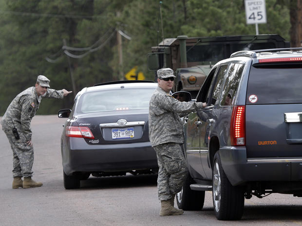 National guardsmen speak to motorists at a road block near the Black Forest Fire in Colorado Springs, Colo., on June 14, 2013.