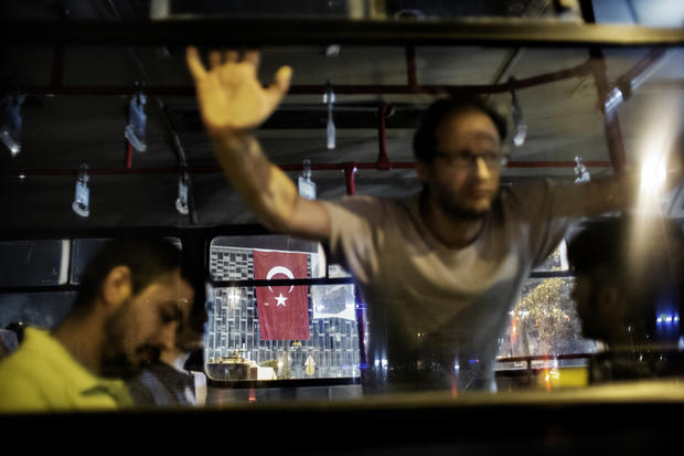 Turkey protesters held in a truck after being arrested on Tasksim Square