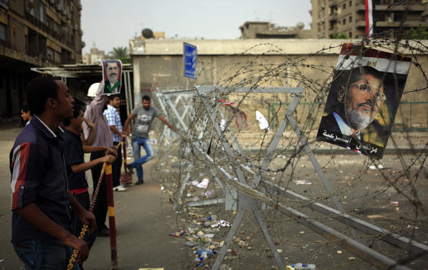 Supporters of ousted President Mohammed Morsi protest at the Republican Guard building in Nasr City, Cairo, Egypt, July 9, 2013.
