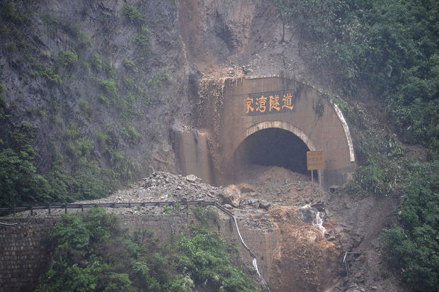 A Chinese highway tunnel is blocked by a rain-triggered landslide in Wenchuan, Sichuan province