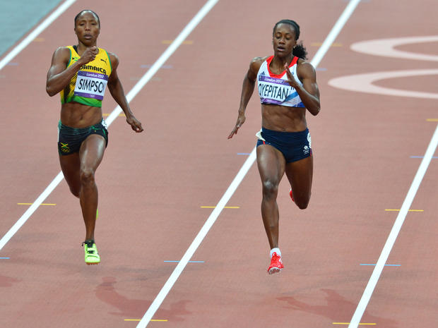 Jamaica's Sherone Simpson (left) and Britain's Abiodun Oyepitan compete in the women's 200m heats during the London 2012 Olympic Games