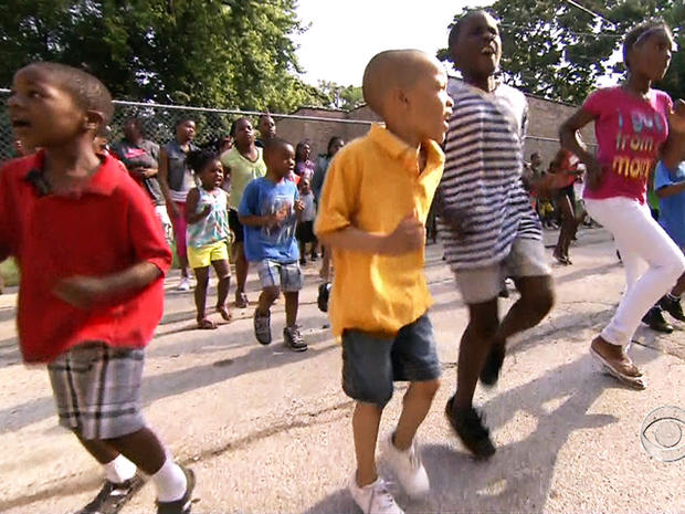 Kids play on the black top playground at the summer camp at New Mount Calvary Baptist Church in Chicago.