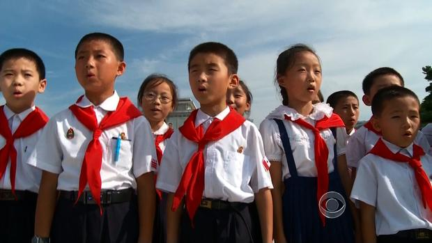 North Korean children sing at a ceremony in Pyongyang at the mausoleum holding Kim Jong Il.