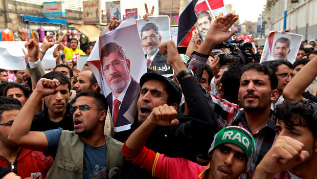 Supporters of Egypt's ousted president Mohamed Morsi shout slogans condemning the latest killings in Egypt during a demonstration in the Yemeni capital, Sanaa, on July 28, 2013.