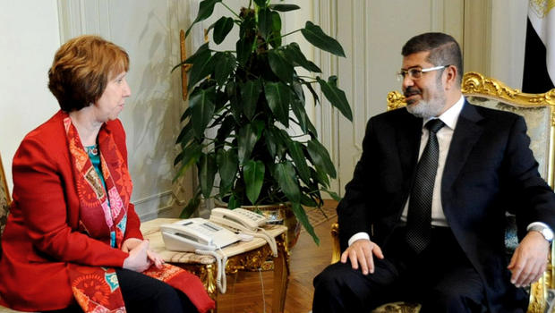 In this Wednesday, June 19, 2013 file image released by the Egyptian Presidency, Egyptian President Mohammed Morsi, right, meets with High Representative of the European Union for Foreign Affairs Catherine Ashton, at the Presidential Palace in Cairo, Egypt. Ashton held a two-hour meeting with Morsi, the EU said on Tuesday, July 29, 2013, in the Islamist leader's first meeting with an outsider since the military deposed him nearly a month ago.