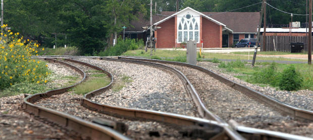 Railroad tracks wind their way through Weimar, Texas, past the Weimar United Church of Christ. The Church's beloved pastor and his wife were murdered in their home behind the church by Resendiz. Texas authorities determined they had a serial killer on the