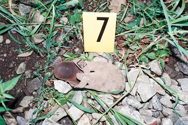 One of Holly's sandals lays in the ditch near the railroad tracks where Resendiz brutally attacked her and Chris. After waking up after the attack, Holly walked barefoot over rocks and broken glass on the tracks to get to a house seeking help.