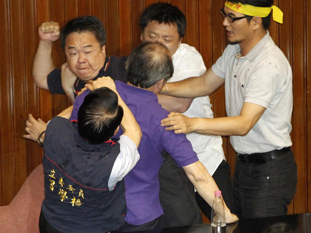 Ruling and opposition lawmakers fight on the legislature floor in Taipei, Taiwan, Aug. 2, 2013.