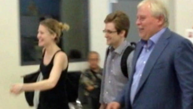 Edward Snowden (center) leaving Moscow's Sheremetyevo airport with lawyer Anatoly Kucherena (right) and WikiLeaks representative Sarah Harrison