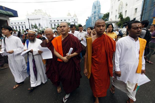 Burma Buddhist monks, Hindu, Muslim and Christian priests march to mark the 25th anniversary of Burma's pro-democracy uprising in Yangon, Burma.