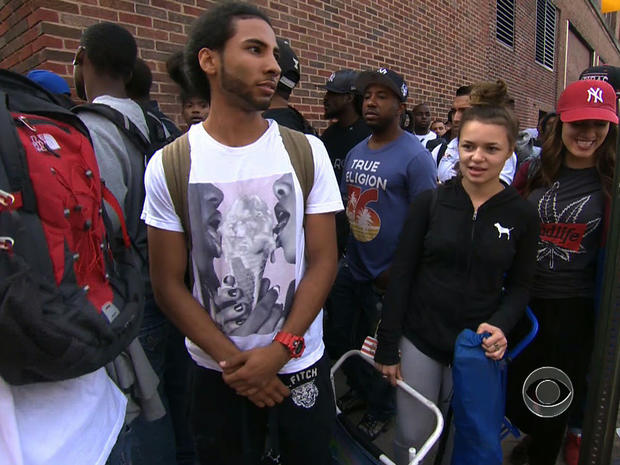 """Job-seekers line up for a carpenter apprenticeship in New York in a """"CBS Evening News"""" segment broadcast Aug. 21, 2013."""