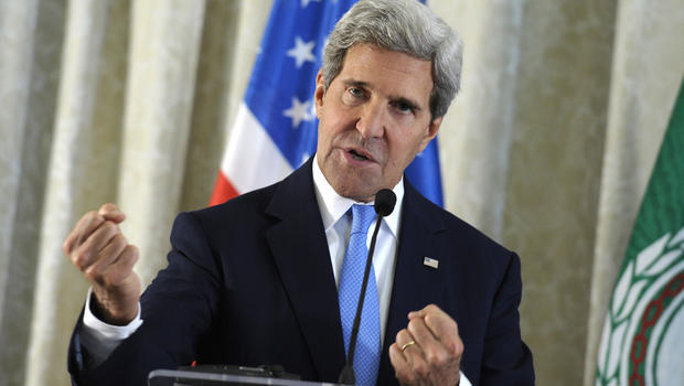 U.S. Secretary of State John Kerry answers a question during a news conference at the United States Embassy in Paris, Sunday, Sept. 8, 2013.