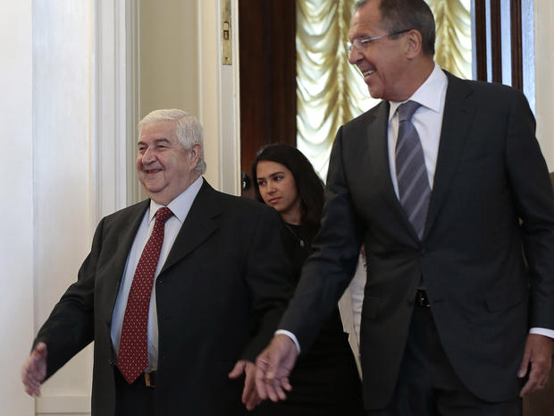 Russian Foreign Minister Sergey Lavrov welcomes his Syrian counterpart Walid Muallem to Moscow