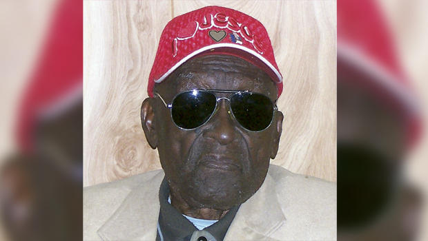 In this 2011 photo provided by the Pine Bluff Commercial, Monroe Isadore poses for photos on his 105th birthday in Pine Bluff, Ark.