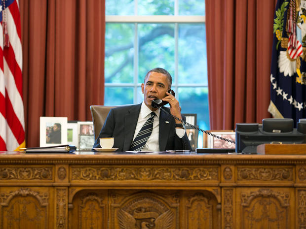 President Obama talks with President Hassan Rouhani of Iran during a phone call in the Oval Office at the White House in Washington Sept. 27, 2013.