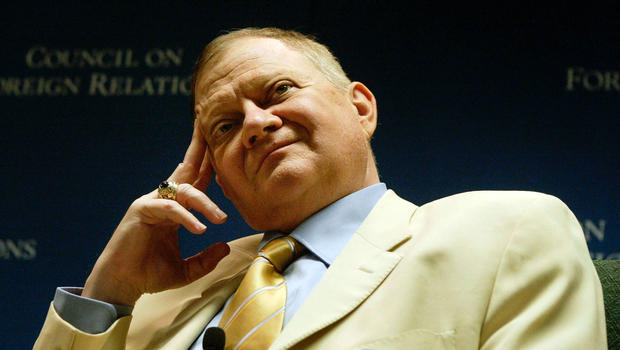 Author Tom Clancy listens to questions during a discussion June 1, 2004, in Washington.