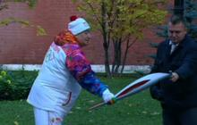 Watch: Olympic torch goes out, civilian comes to rescue