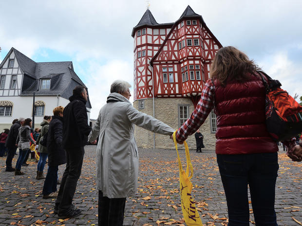 Protestors form a human chain from the the cathedral to the new residence of the Bishop of Limburg
