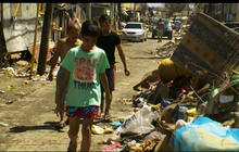 Tacloban starts cleaning up as residents continue to wait for aid