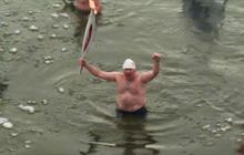 2014 Sochi Olympics torch taken for an icy swim