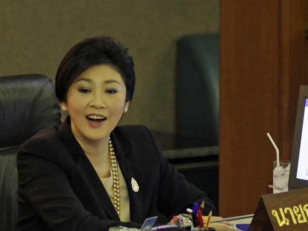 Thai Prime Minister Yingluck Shinawatra reacts after a no-confidence vote at the parliament in Bangkok