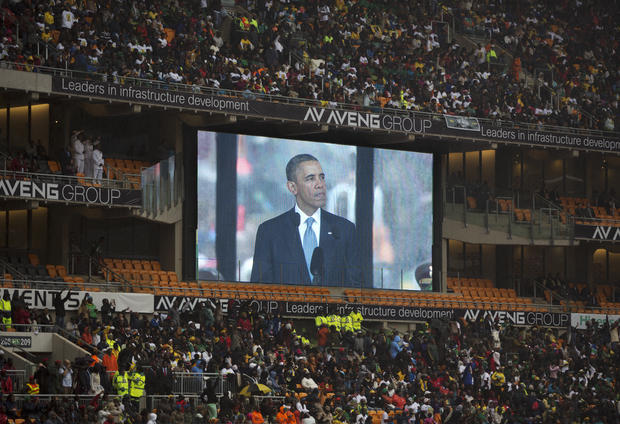 President Obama speaks to mourners attending the memorial service for former South African president Nelson Mandela at the FNB Stadium in Soweto near Johannesburg