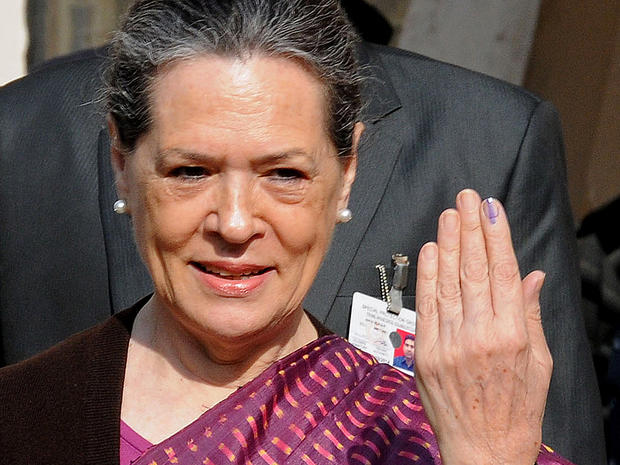 India's Congress Party president Sonia Gandhi poses with her ink-marked finger after casting her vote in the Delhi state assembly election in New Delhi, Dec. 4, 2013.