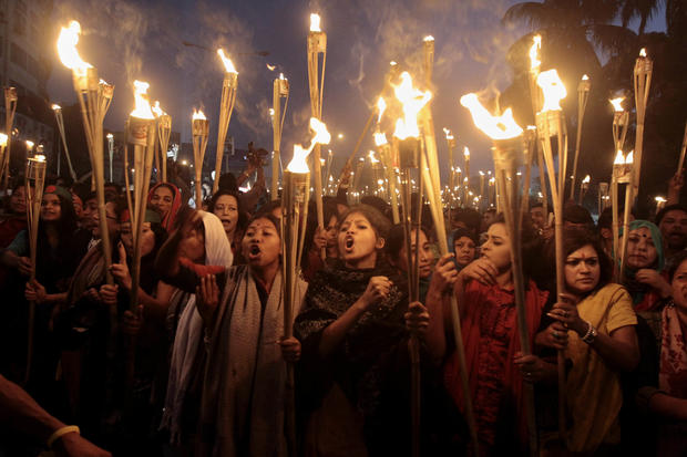Bangladeshi activists shout slogans as they participate in a torch rally in Dhaka, Bangladesh.