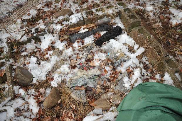 Officers searched for a woodpile in the yard to corroborate Schirmer's story, and did find one.